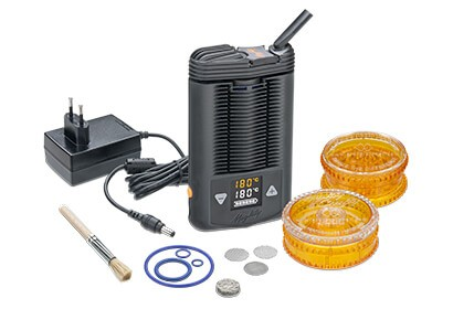 Mighty dry herb vaporizer with a charger, cleaning brush, mesh screens, two grinders and rubber bands