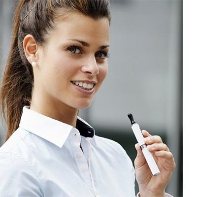 Young Brunette irresistible Smile while Holding white Vape Pen