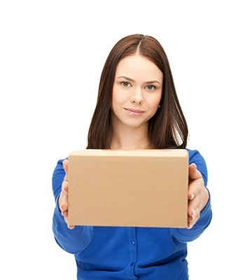 Young female in blue shirt is holding a packaging box