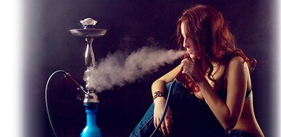 water pipe hookah being smoked by a girl