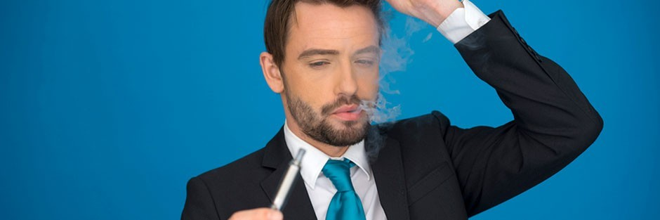 A confused man in a business suit looking at an electronic cigarette, also known as vape pen
