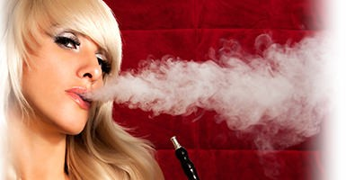 hookah being exhaled by a pretty model on a red background