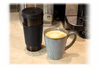 Vapor Cup vaporizer next to a coffee mug with coffee inside