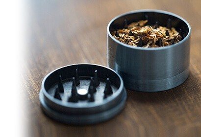 herb grinder with herbs inside