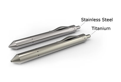 Grasshopper vape pen shown next to titanium and stainless steel