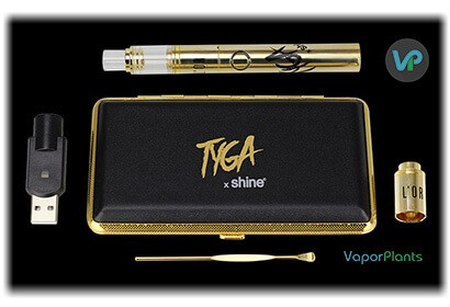Atmos L'Or in gold next to usb charger, loading tool for wax and carrying case