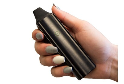 a female hand holding VaporFi Atom vaporizer