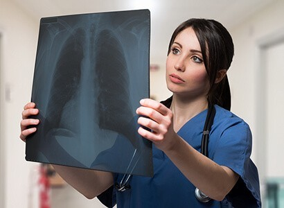 Nurse is examining a lungs radiology chart