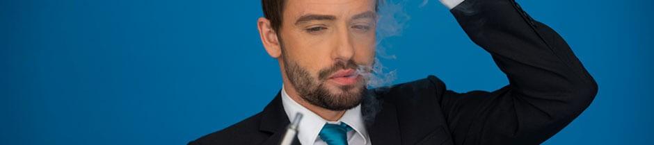 A man in a suit is holding a CBD vape pen with confusion