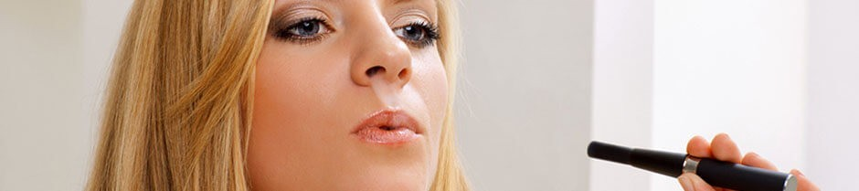 young female is exhaling vapor from her vapor pen